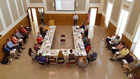 View from above overlooking meeting group participants